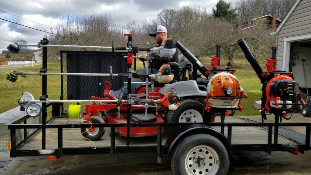 A trailer loaded up with lawn care equipment.